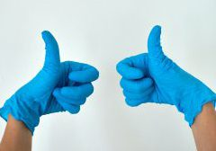 Two gloved hands in a thumbs up